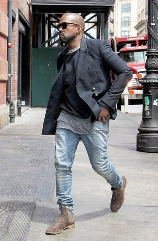 Kanye West wearing Black Double Breasted Blazer, Black Crew-neck Sweater, Grey Crew-neck T-shirt, Light Blue Jeans