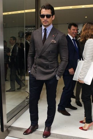 David Gandy wearing Charcoal Double Breasted Blazer, Light Blue Dress Shirt, Navy Chinos, Burgundy Leather Oxford Shoes