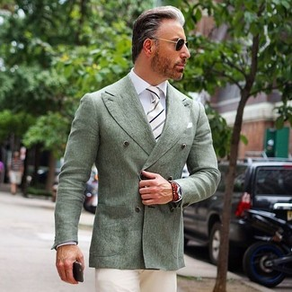How to wear: mint double breasted blazer, white dress shirt, beige chinos, white and black vertical striped tie