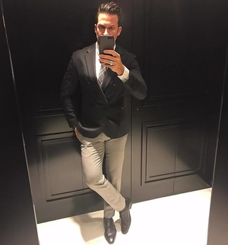 Try pairing a black double breasted blazer with beige dress pants like a true gent. Add a sportier twist to your outfit with black leather double monks. So if it's a warm summertime day and you want to look dapper without exerting much effort, this ensemble will do the job in seconds time.