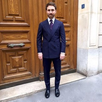 How to wear: navy vertical striped double breasted blazer, white dress shirt, navy vertical striped dress pants, black leather tassel loafers