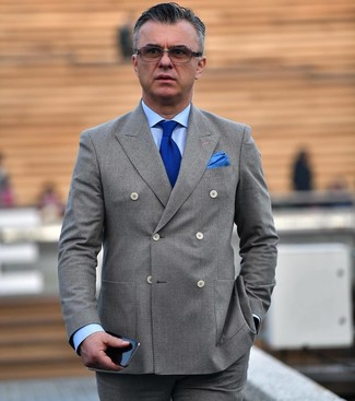 How to wear: grey double breasted blazer, light blue dress shirt, grey dress pants, blue knit tie