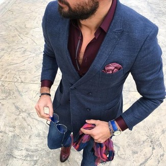 How to wear: navy wool double breasted blazer, burgundy dress shirt, blue skinny jeans, brown leather monks