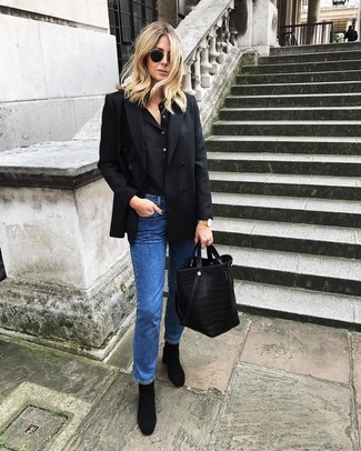 How to wear: black double breasted blazer, black henley shirt, blue jeans, black suede ankle boots