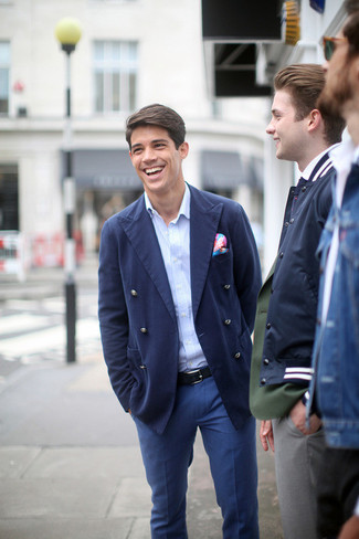 Pairing a navy double breasted blazer and blue trousers will create a powerful and confident silhouette. There are many ways to look neat and survive the blazing hot weather, and that's one of them.