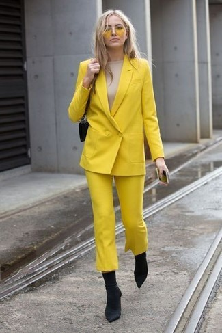 Look stylish yet practical in a yellow double breasted blazer and yellow sunglasses. Black elastic ankle boots look amazing here. We're loving how perfect this one is for transitional weather.
