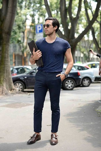 How to wear: black woven leather zip pouch, brown leather double monks, navy chinos, navy crew-neck t-shirt