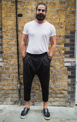 How to Wear a Black Watch For Men: Wear a white crew-neck t-shirt and a black watch, if you enjoy relaxed dressing but also want to look stylish. You can take a classic approach with shoes and complement your ensemble with a pair of black leather double monks.
