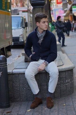 How to Wear Dark Brown Suede Double Monks: This pairing of a navy shawl cardigan and white chinos is proof that a safe ensemble can still be really stylish. Get a bit experimental when it comes to shoes and polish off your look by wearing dark brown suede double monks.
