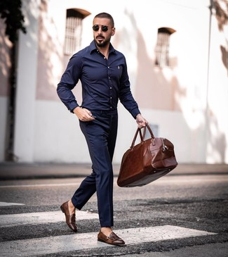 How to wear: brown leather holdall, brown leather double monks, navy dress pants, navy long sleeve shirt
