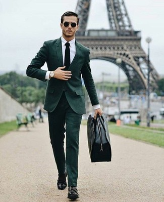 How to wear: black leather holdall, black leather double monks, white dress shirt, dark green suit