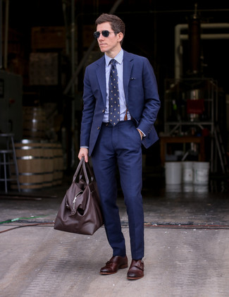 How to wear: dark brown leather duffle bag, dark brown leather double monks, light blue dress shirt, navy suit