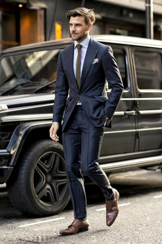 How to wear: olive knit tie, brown leather double monks, light blue vertical striped dress shirt, black suit