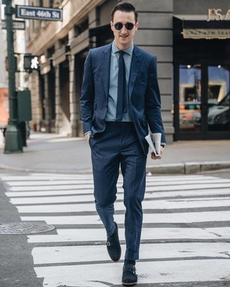 How to wear: navy tie, navy suede double monks, light blue chambray dress shirt, navy vertical striped suit
