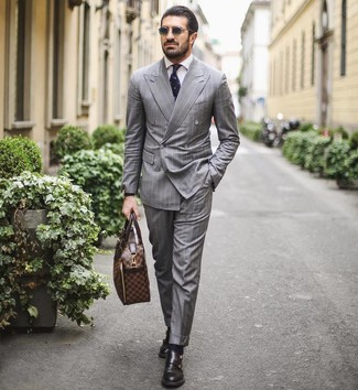 How to wear: brown leather briefcase, black leather double monks, white dress shirt, grey vertical striped suit