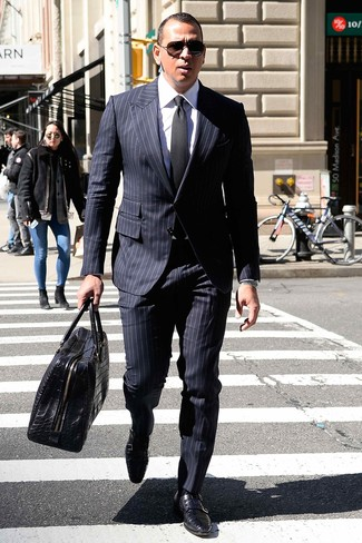 How to wear: black leather holdall, black leather double monks, white dress shirt, navy vertical striped suit