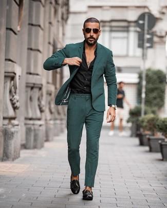 How to wear: dark brown sunglasses, black leather double monks, black dress shirt, dark green suit