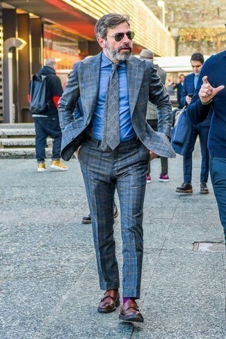 How to Wear Navy Suspenders: If you're after a laid-back yet seriously stylish look, make a blue plaid suit and navy suspenders your outfit choice. Serve a little mix-and-match magic with brown leather double monks.