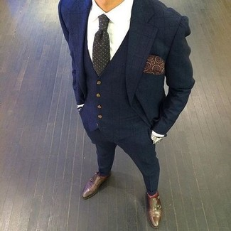 How to wear: charcoal polka dot tie, dark brown leather double monks, white dress shirt, navy check three piece suit