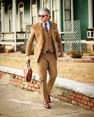 How to wear: brown leather briefcase, brown leather double monks, light blue dress shirt, tan corduroy three piece suit
