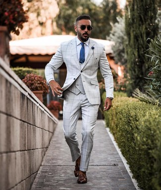 How to wear: blue silk tie, dark brown leather double monks, white dress shirt, grey check three piece suit