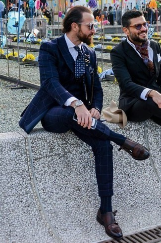 How to Wear Dark Brown Leather Double Monks: A navy check three piece suit and a white dress shirt are worth adding to your list of essential menswear styles. Complete this outfit with a pair of dark brown leather double monks to mix things up a bit.
