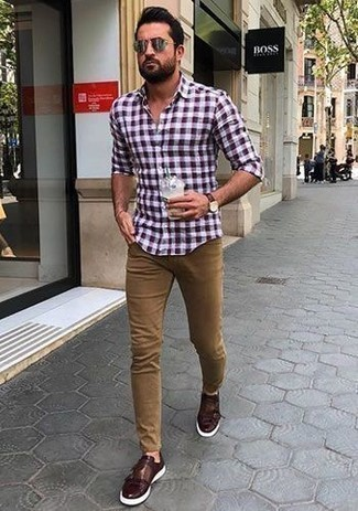 How to Wear Khaki Jeans For Men: This pairing of a burgundy gingham long sleeve shirt and khaki jeans is impeccably stylish and yet it's relaxed and ready for anything. Complete your outfit with a pair of burgundy leather double monks to easily boost the style factor of your getup.
