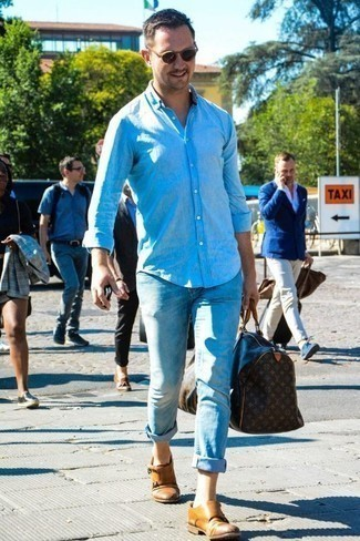 How to Wear a Duffle Bag For Men: Consider wearing a light blue chambray long sleeve shirt and a duffle bag for a relaxed casual getup with a contemporary spin. Tan leather double monks will inject a dash of elegance into an otherwise utilitarian ensemble.