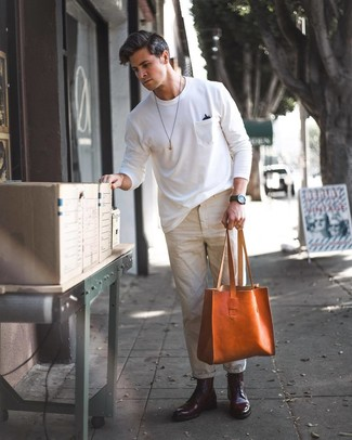 How to wear: tobacco leather tote bag, burgundy leather dress boots, beige chinos, white crew-neck t-shirt