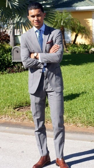 How to Wear a Blue Polka Dot Tie For Men: Team a grey suit with a blue polka dot tie and you'll look like a true style maverick. To introduce a carefree feel to your ensemble, complete your ensemble with tobacco leather dress boots.