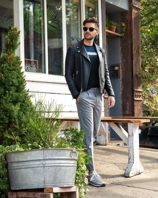 How to wear: grey low top sneakers, grey vertical striped dress pants, navy horizontal striped crew-neck sweater, black leather biker jacket