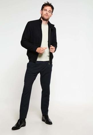 How to wear: black leather derby shoes, black dress pants, beige crew-neck sweater, black bomber jacket