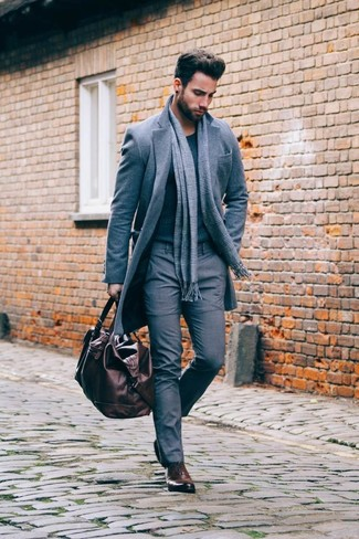 How to Wear a Dark Brown Leather Holdall In Cold Weather For Men: Wear a grey overcoat with a dark brown leather holdall for a fashionable and easy-going ensemble. A pair of dark brown leather oxford shoes will put a different spin on an otherwise simple ensemble.