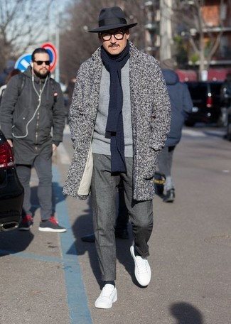 How to wear: white leather low top sneakers, charcoal dress pants, grey crew-neck sweater, grey herringbone overcoat