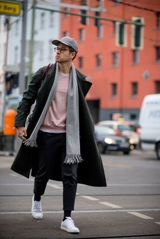How to wear: white low top sneakers, black dress pants, pink crew-neck sweater, olive overcoat