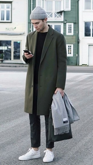 How to wear: white leather low top sneakers, black dress pants, black crew-neck sweater, olive overcoat