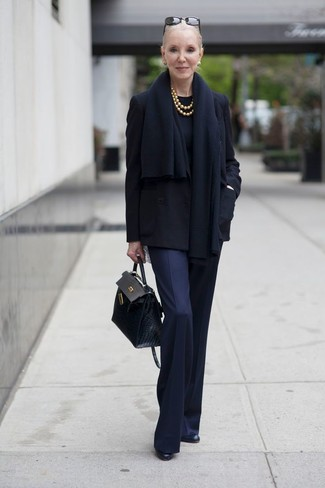 How to wear: black leather ankle boots, navy dress pants, black crew-neck sweater, black pea coat