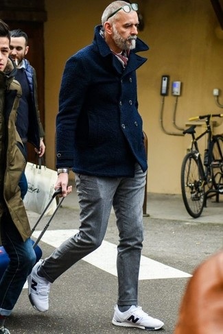 How to Wear a Navy Pea Coat: Loving how this combination of a navy pea coat and grey wool dress pants instantly makes you look sophisticated and stylish. You know how to tone it down: white athletic shoes.