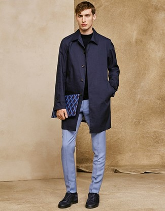 How to wear: navy suede low top sneakers, light blue dress pants, black crew-neck sweater, navy raincoat