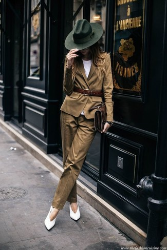 How to Wear a Tan Blazer For Women: Consider wearing a tan blazer and khaki dress pants and you'll put together a proper and sophisticated look. White leather pumps are the glue that brings your look together.