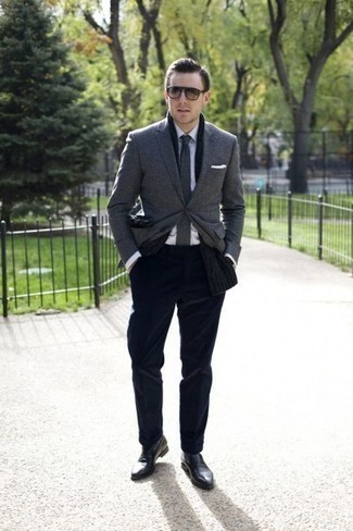 Men's Looks & Outfits: What To Wear Smart Casually: Combining a grey blazer and navy dress pants will hallmark your sartorial chops. We're totally digging how this whole outfit comes together thanks to a pair of black leather loafers.