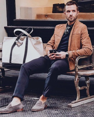 How to wear: grey suede loafers, navy vertical striped dress pants, black crew-neck t-shirt, tobacco suede bomber jacket