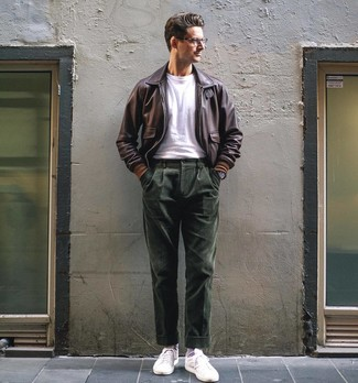 How to wear: white low top sneakers, dark green corduroy dress pants, white crew-neck t-shirt, dark brown leather bomber jacket