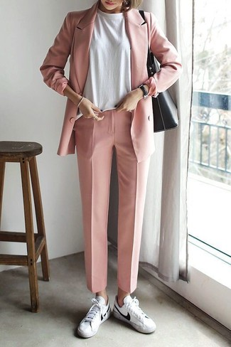 How to Wear a Pink Double Breasted Blazer For Women: As you can see, looking stylish doesn't require that much effort. Pair a pink double breasted blazer with pink dress pants and you'll look wonderful. Ramp up the appeal of your outfit by finishing with white leather low top sneakers.