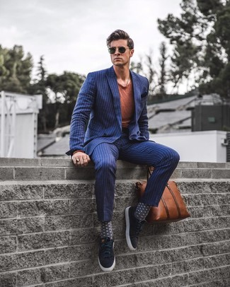 How to wear: black suede tassel loafers, navy vertical striped dress pants, tobacco crew-neck t-shirt, navy vertical striped double breasted blazer