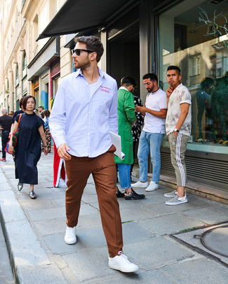 How to wear: white low top sneakers, brown dress pants, white crew-neck t-shirt, light blue vertical striped long sleeve shirt