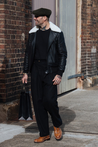 How to wear: tan leather brogues, black dress pants, black crew-neck t-shirt, black and white shearling jacket