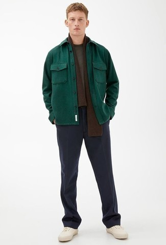 How to Wear Navy Dress Pants For Men: For an outfit that's polished and wow-worthy, pair a dark green shirt jacket with navy dress pants. Finish off with a pair of white canvas low top sneakers to punch up this ensemble.