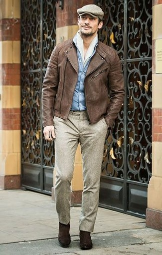 How to wear: dark brown suede chelsea boots, beige wool dress pants, light blue denim shirt, brown leather biker jacket
