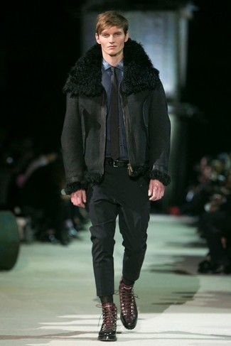 How to wear: dark brown leather casual boots, black dress pants, navy denim shirt, black shearling jacket